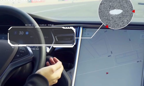 A photo of the dashboard of Tesla Model S shows how researchers at Tencent were able to trick the lane detection system.